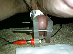 Ball sack crushed in vice and electrocuted with estim and cum