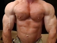 Muscle Hairy man Tom Lord Showcases Off His Muscles And Spunks Rigid