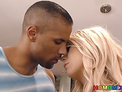 Light-haired she-creature Aubrey Kate gets pummeled by a dark-hued dude