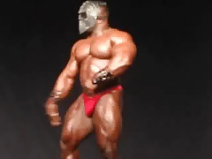 Str8 bodybuilder flexing on stage